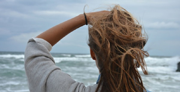 tousled hair on the beach